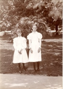 Elsie & her older sister Hylinda before they moved from Virginia to California. Appears they were at the cemetery